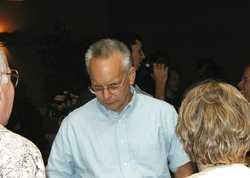 Bob Bedle talking with Doug and Arlene Skokna.